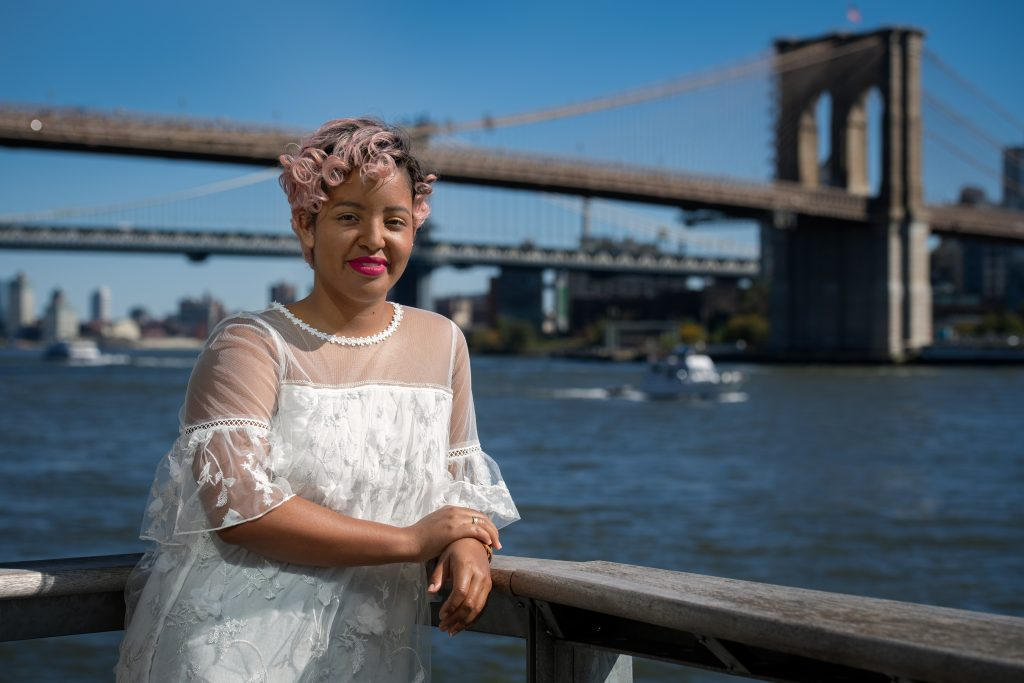 Shanaé Burch '13 with the Brooklyn Bridge in the background  | Photo by Derek Palmer