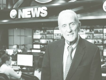 Edmund Ansin in a news studio