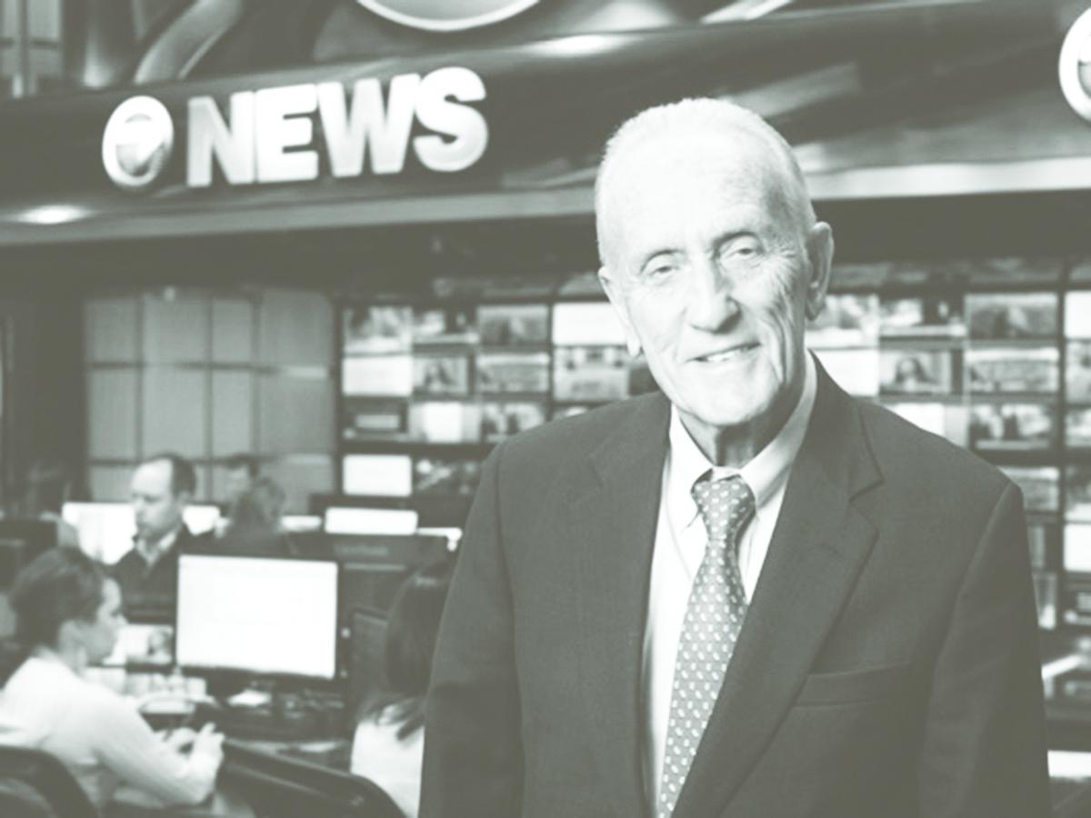 Edmund Ansin in a news studio