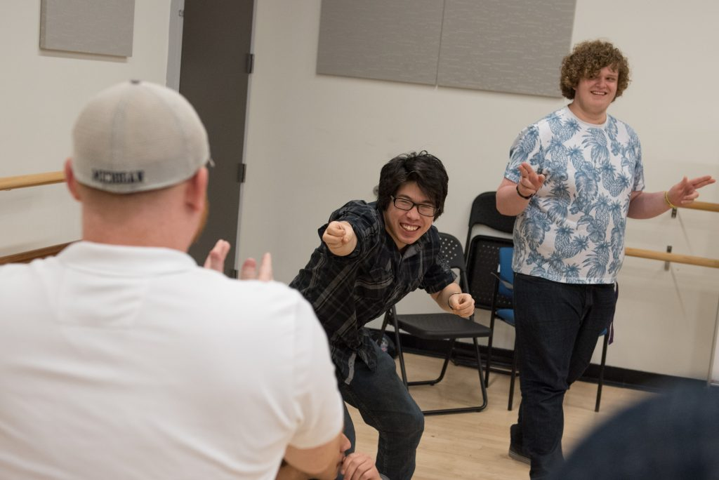 Students acting in an improv class