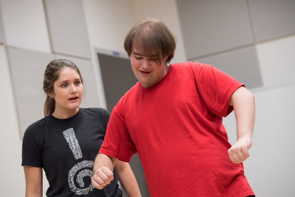 Two students together in an improv class
