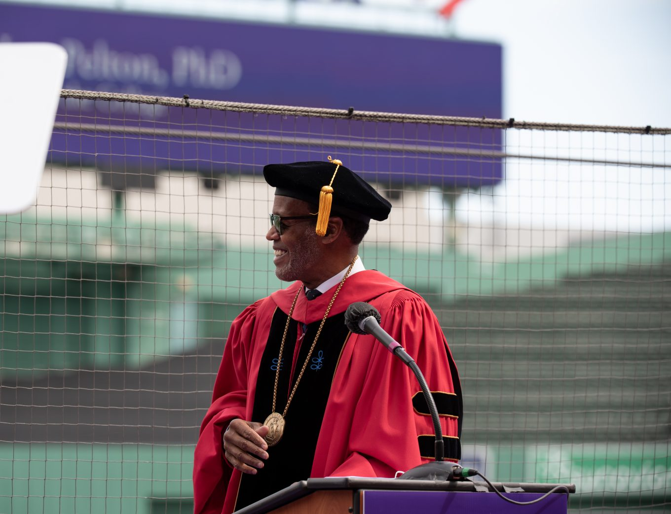 President Lee Pelton smiling after giving speech at Commencement 2021