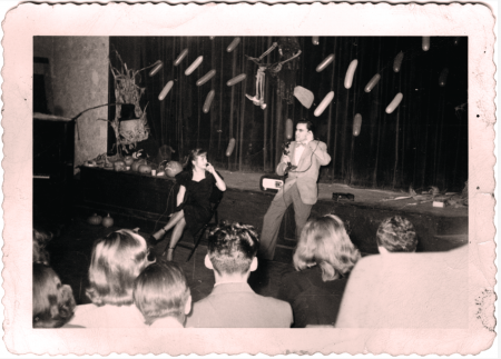 Bill Dana '50 on stage performing during a Halloween event