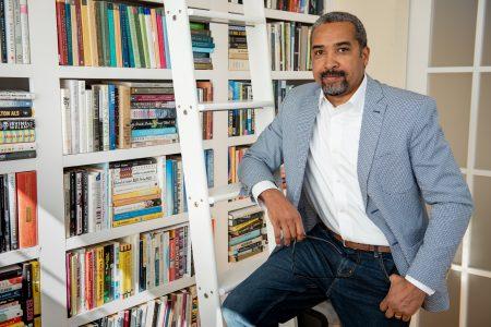 Portrait of Jerald walker sitting in office in front of a bookshelf